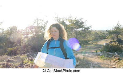 Young woman traveler with a backpack and a map. Travel...