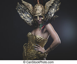 Latin woman with green hair and gold costume with handmade...