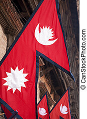 Flags of Nepal against a backdrop of a traditional Nepalese...