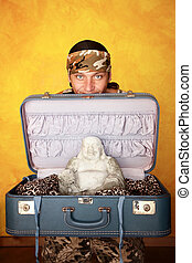 Man with Buddha in suitcase