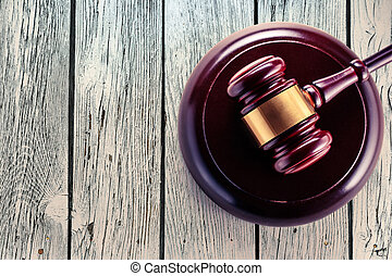 Wooden gavel and block closeup in toning