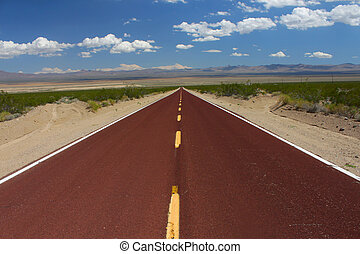 Long Road Through the Mojave Desert - A road runs through...