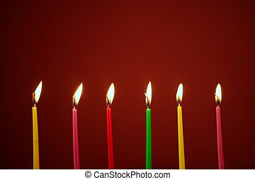 Colorful birthday candles in a row - Colorful birthday light...