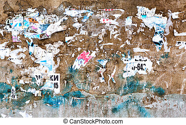 Old weathered grunge brick wall with scraps of old paper as...