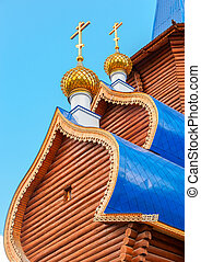 Domes with crosses on wooden orthodox church in Samara,...
