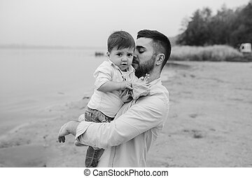 Dad with little son in her arms