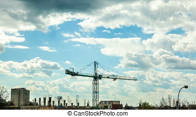 Beautiful time lapse of crane on industrial construction...