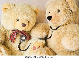 Pediatrics - Teddy bears with stethoscope posing as doctor...