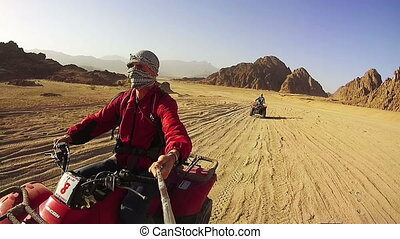 Riding on Quad Bikes in the Desert of Egypt. Driving ATVs....