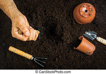 Gardening equipment and hand with soil