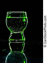 Glass shined with colored light on a black background. Low...