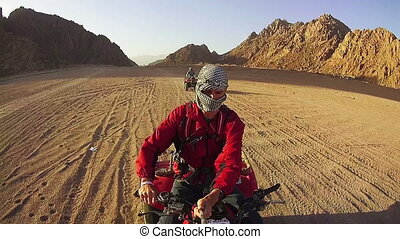 Driving ATVs in the Desert of Egypt. Riding on Quad Bikes in...