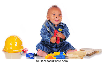 Saw-Happy Baby - A happy biracial baby holding a handsaw...