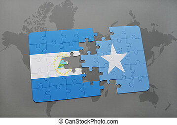 puzzle with the national flag of nicaragua and somalia on a...