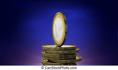 Rotating euro coins - business concept