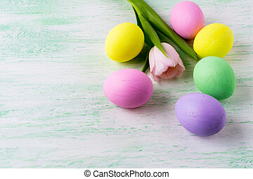 Easter eggs and pink tulip - Easter background with pastel...