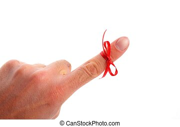 bow - red bow on male finger showing reminder or dont forget...