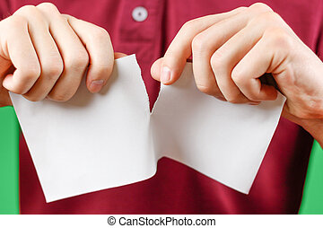 Man tearing a piece of paper in half blank white flyer...