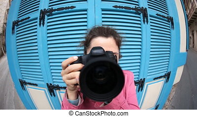 Funny Young woman photographer with camera. Fish eye - Young...