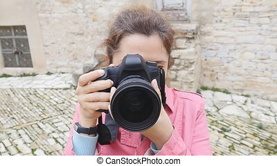 Young woman photographer with camera - Young woman travaler...