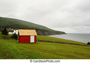 Cape Breton Highlands - Red barn at Cape Breton coastline,...