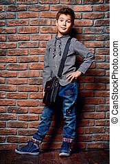 trendy pre-teen - Kid's fashion. Modern nine year old boy...