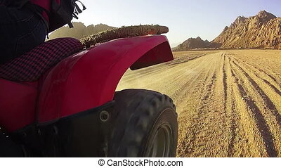 Extreme Driving of the ATV in the Desert of Egypt, view of the Rear Wheel