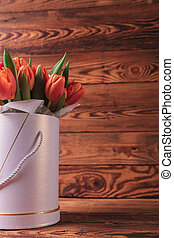 cutout image of a flowers box with orange tulips on wood...