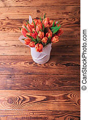 spring flowers bouquet on old wooden background