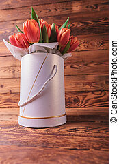fresh spring tulips in a flowers box on old wooden...