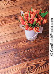 tulips flower arrangement on old wood background - picture...