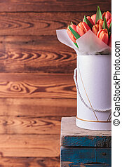 flowers box with orange tulips on a chair - cutout image of...