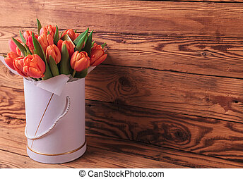 beautiful fresh spring tulips in a box with copy space on...