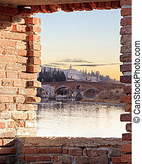 Old Verona town, view through brickwall window - historical...