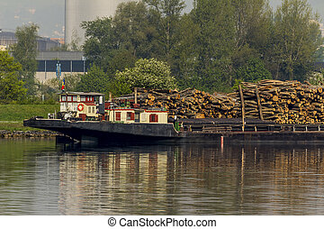 laden ship with wood - loaded on a boat on the danube in...