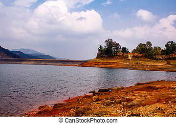 2.Description: Umiam Lake (It is a man-made lake ) is located in the hills 15 km to the North of Shillong in the state of Meghalaya, India. It was created by damming the Umiam river in the early 1960s.