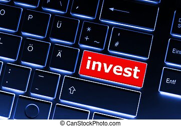 invest or investment key or button in red showing business...