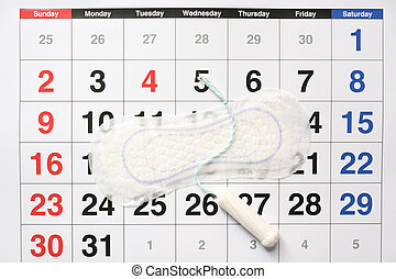 Menstrual tampons and pads on a calendar page - Menstrual...