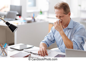 Photo of sick man having nasal problems - Give me napkin....