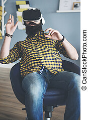 Bearded man watching movie using 3d glasses