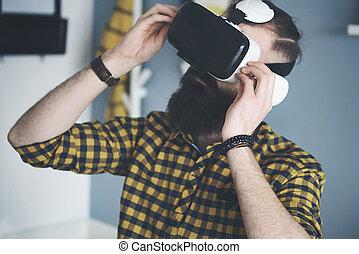 Bearded man using smart glasses