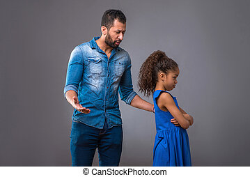 Young black father with his teenage daughter - A young black...