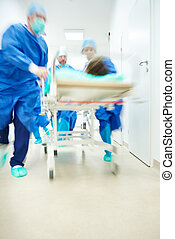 Doctors running to the operating room