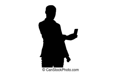 Silhouette Young businessman taking selfies on phone....