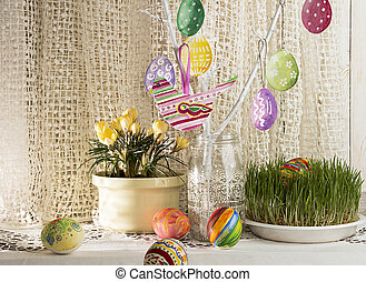 Easter holiday background with branch, painted Easter eggs and bird