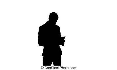 Silhouette Young businessman using tablet computer....