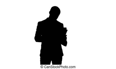 Silhouette Concentrated businessman reading financial...