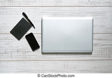 View of a tabletop - View of a wooden table with a laptop,...