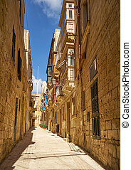 The narrow street and residential houses of Valletta, Malta....
