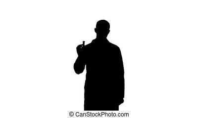 Silhouette Young doctor presenting brand new medicine....